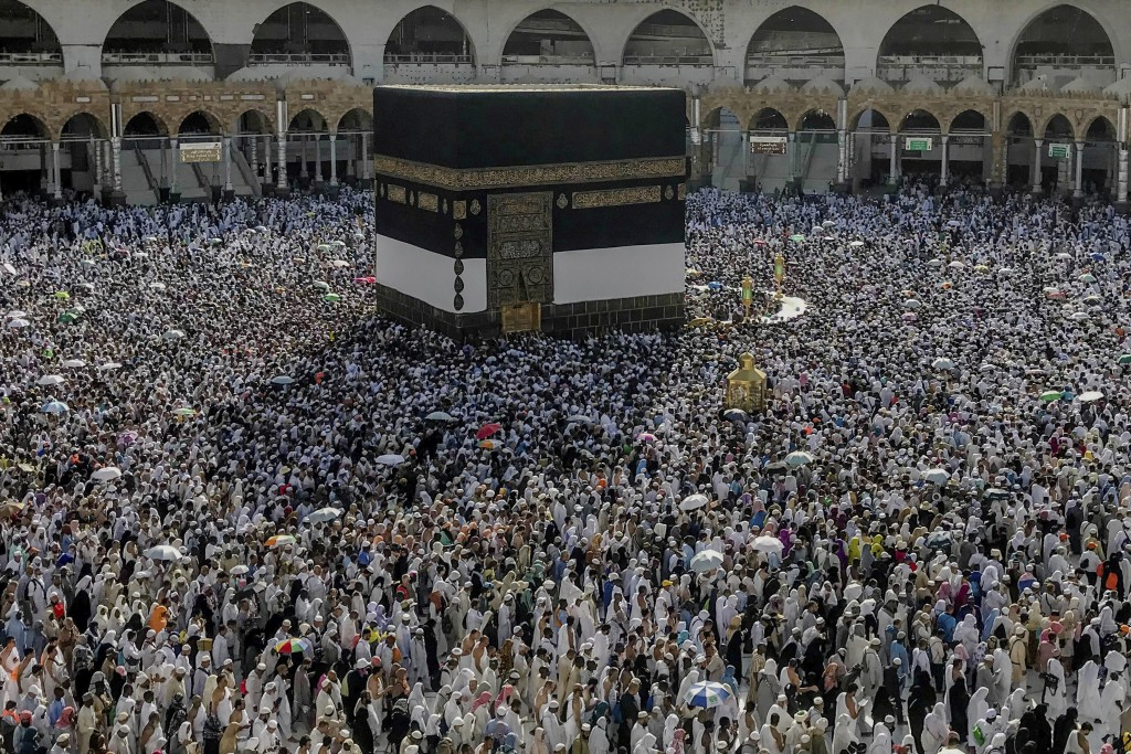 Muslim pilgrims circumambulate around the Kaaba in the Grand Mosque, ahead of the annual Hajj pilgrimage, in the Muslim holy city of Mecca, Saudi Arab...