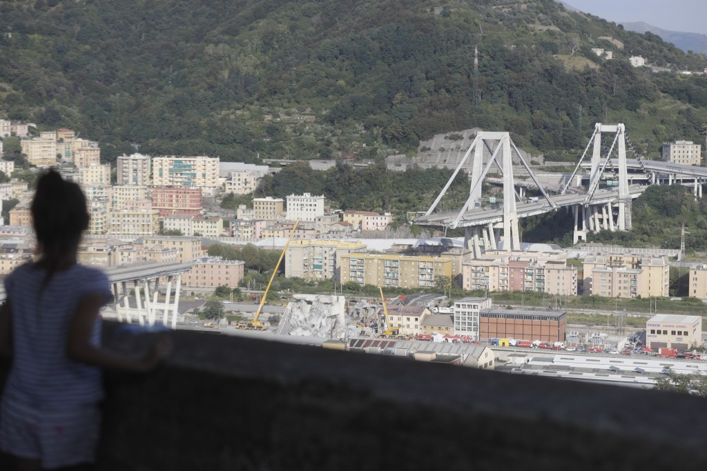 A view of the collapsed Morandi highway bridge in Genoa, Italy, Friday, Aug. 17, 2018. Excavators have begun clearing large sections of the collapsed ...