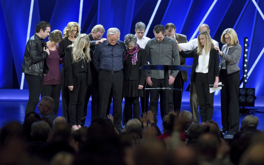 FILE - In this Tuesday, April 10, 2018 file photo, Willow Creek Community Church Senior Pastor Bill Hybels, sixth from left, and other church leaders ...