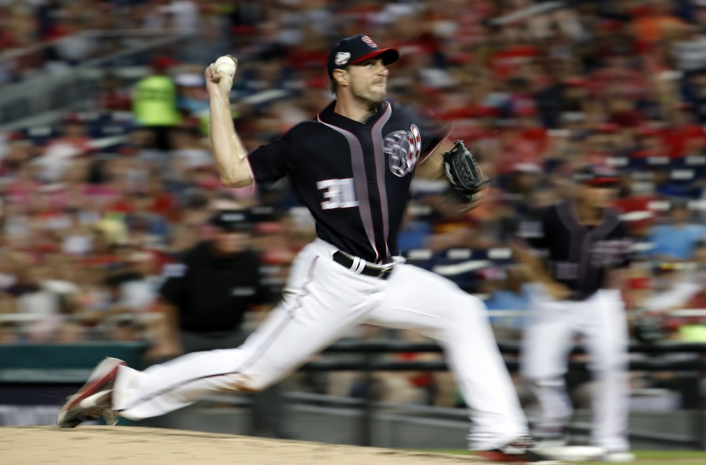 Washington Nationals starting pitcher Max Scherzer throws during the fourth inning of the team's baseball game against the Miami Marlins at Nationals ...