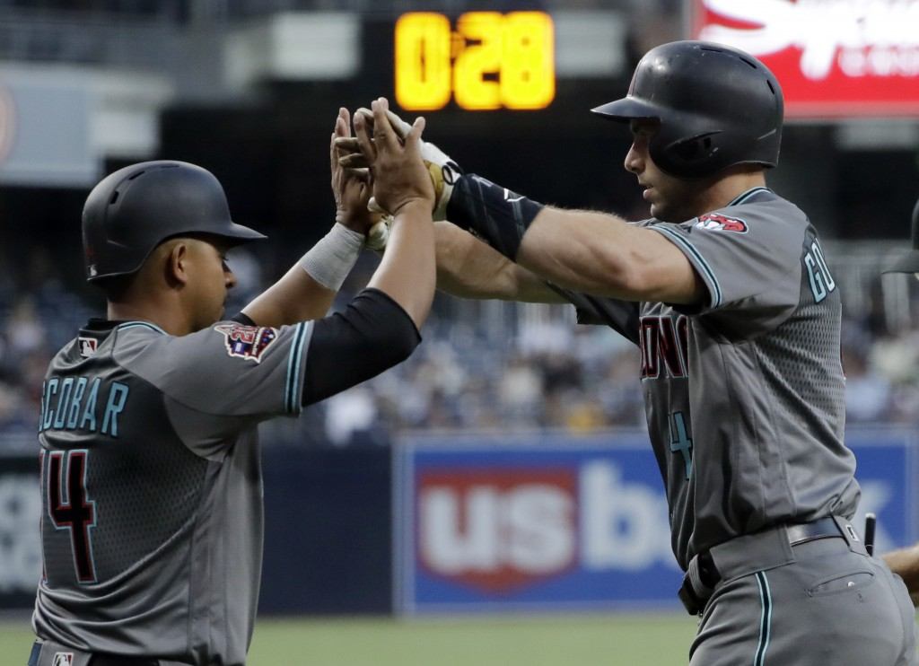Arizona Diamondbacks' Paul Goldschmidt, right, is greeted by Eduardo Escobar after hitting a two-run home run during the first inning of a baseball ga...