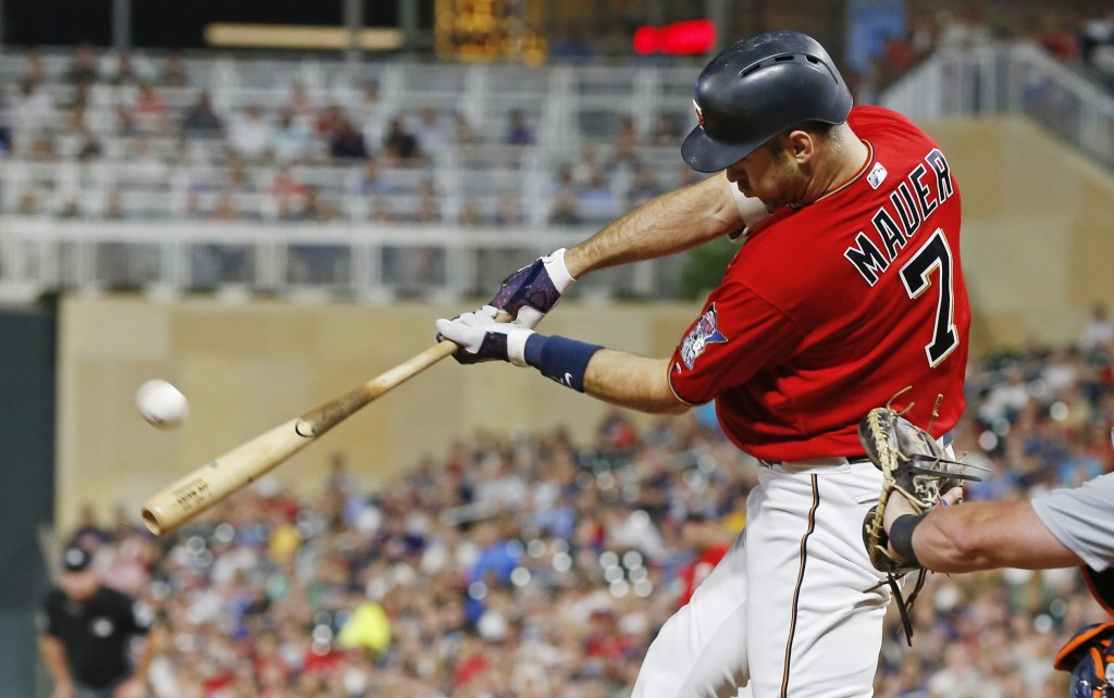Minnesota Twins' Joe Mauer hits a three-run home run off Detroit Tigers pitcher Louis Coleman in the seventh inning of a baseball game Friday, Aug. 17...