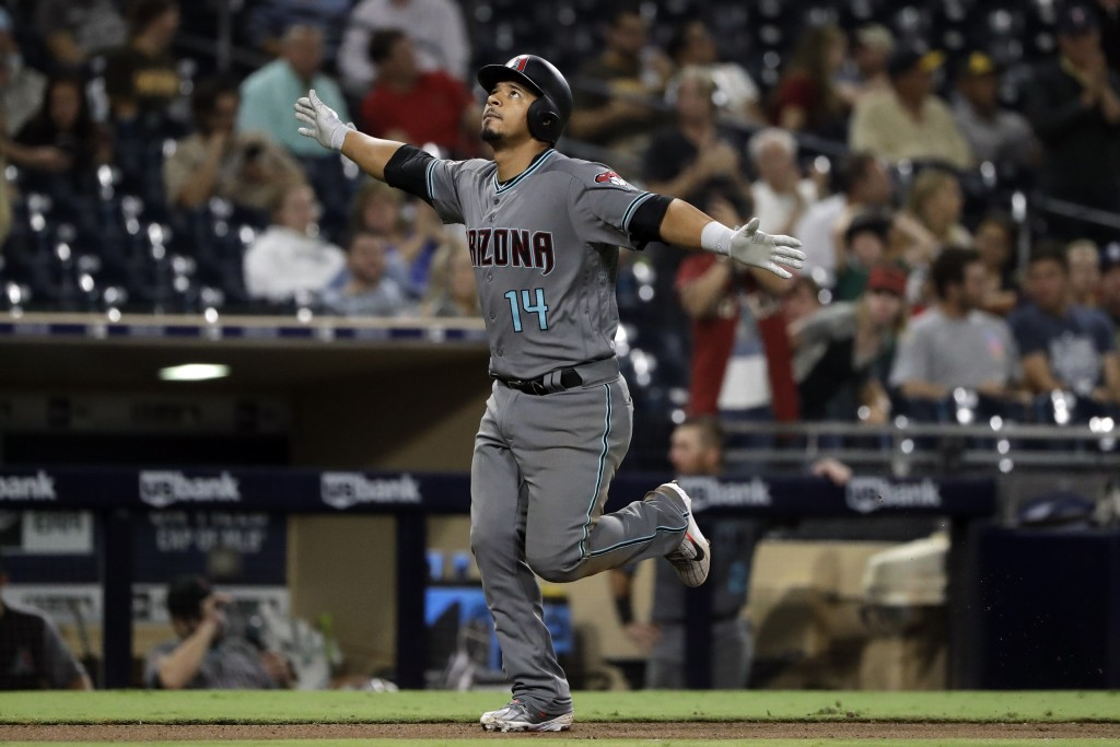 Arizona Diamondbacks' Eduardo Escobar reacts after hitting a home run during the eighth inning against the San Diego Padres in a baseball game Friday,...