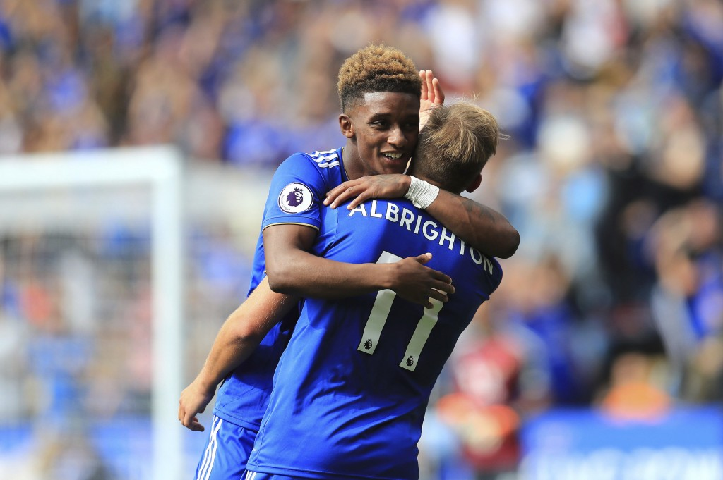 Leicester City's Demarai Gray, left, and Marc Albrighton celebrate after Wolverhampton Wanderers' Matt Doherty (not pictured) scores an own goal durin...