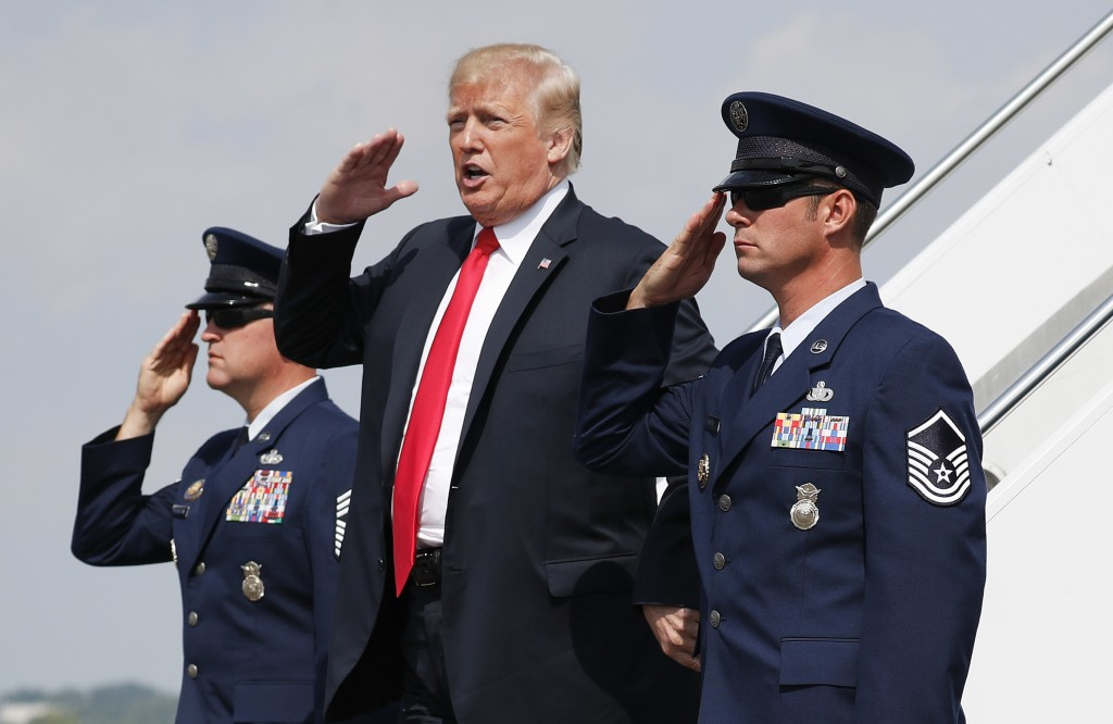 President Donald Trump salutes on his arrival on Air Force One at Morristown Municipal Airport in Morristown, N.J., Friday, Aug. 17, 2018, en route to...