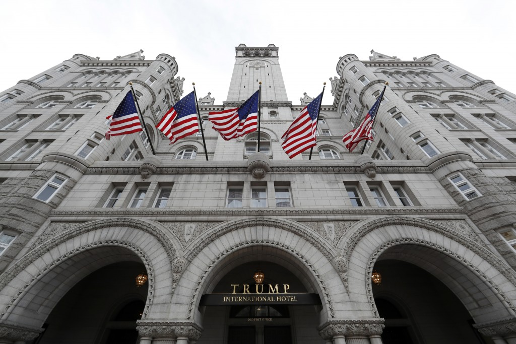 FILE - This Dec. 21, 2016 file photo shows the Trump International Hotel at 1100 Pennsylvania Avenue NW, in Washington. The Justice Department is aski...