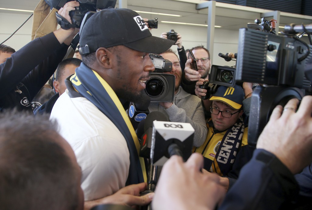 Jamaica's Usain Bolt briefly speaks as he arrives in Sydney, Saturday, Aug. 18, 2018.  Olympic gold medalist sprinter, Bolt is hoping to impress the c...