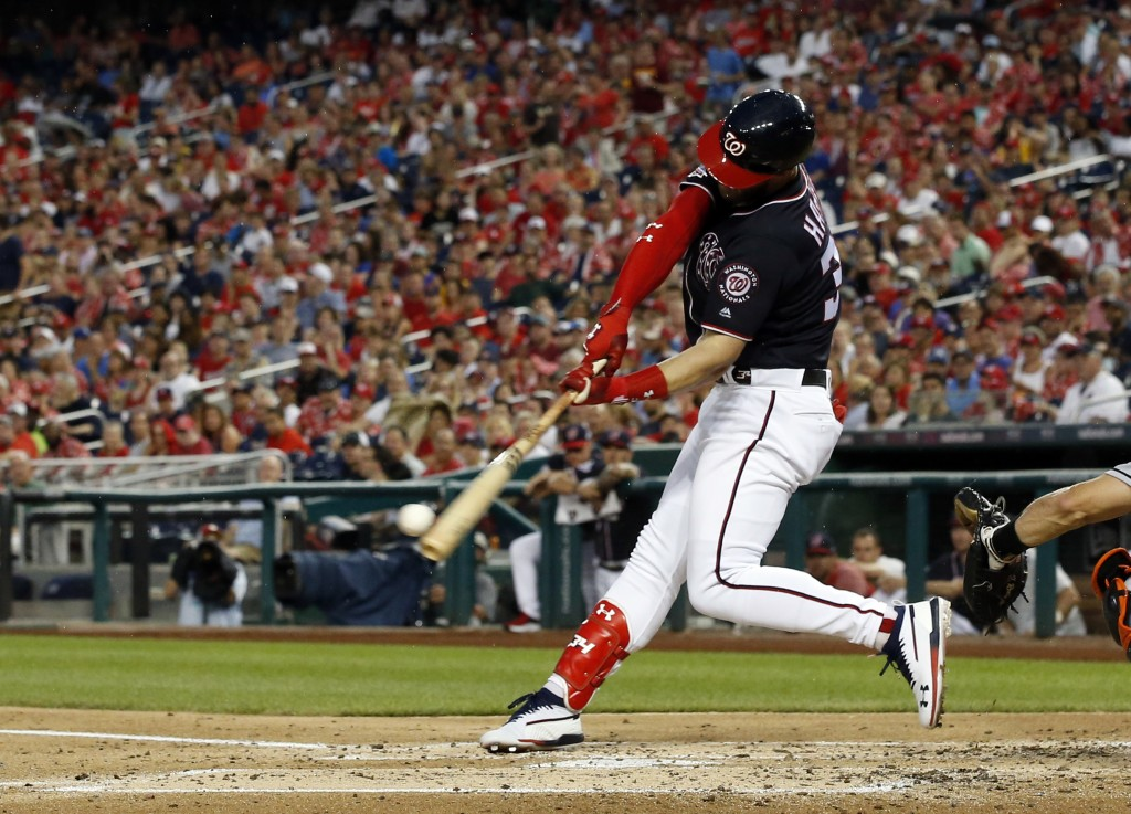 Washington Nationals' Bryce Harper hits an RBI single during the third inning of the team's baseball game against the Miami Marlins at Nationals Park,...