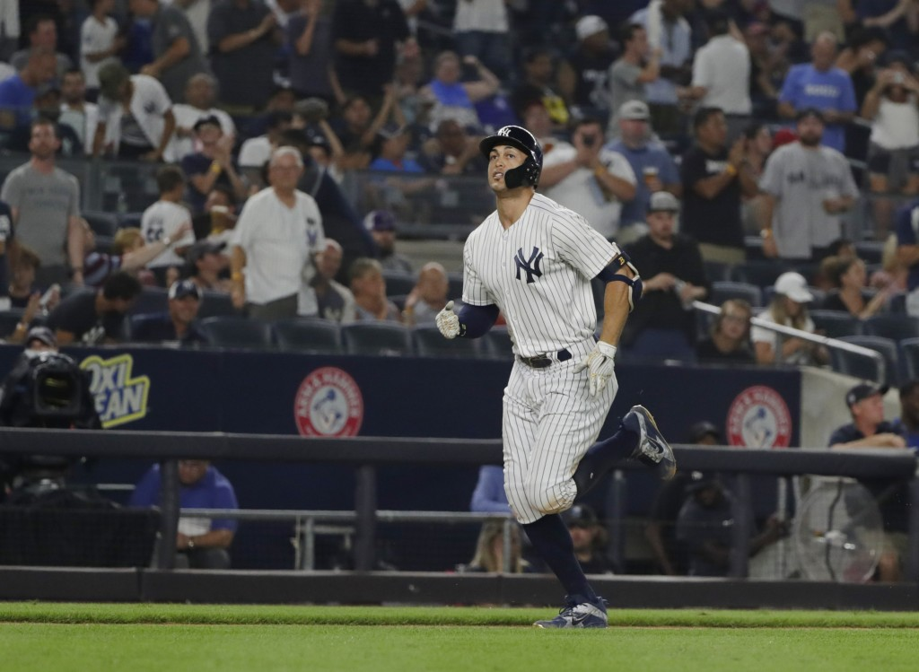 New York Yankees' Giancarlo Stanton runs the bases after hitting a home run during the seventh inning of a baseball game against the Toronto Blue Jays...