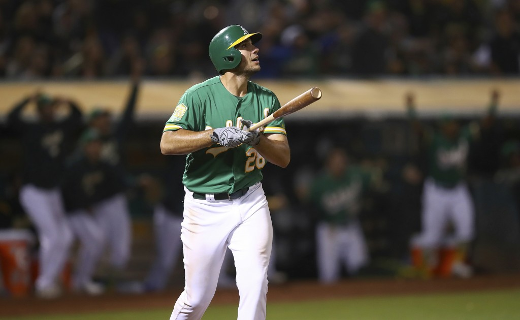 Oakland Athletics' Matt Olson watches his game winning home run hit off Houston Astros' Tony Sipp in the tenth inning of a baseball game Friday, Aug. ...