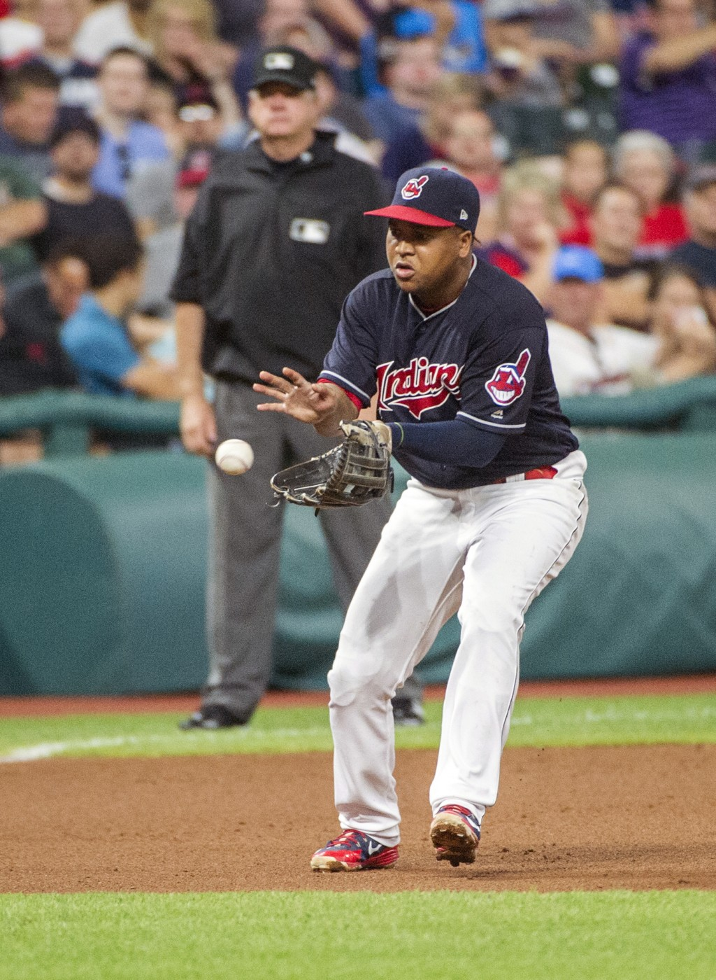 Cleveland Indians' Jose Ramirez catches a ground ball by Baltimore Orioles' Tim Beckham and throws Beckham out during the seventh inning of a baseball...