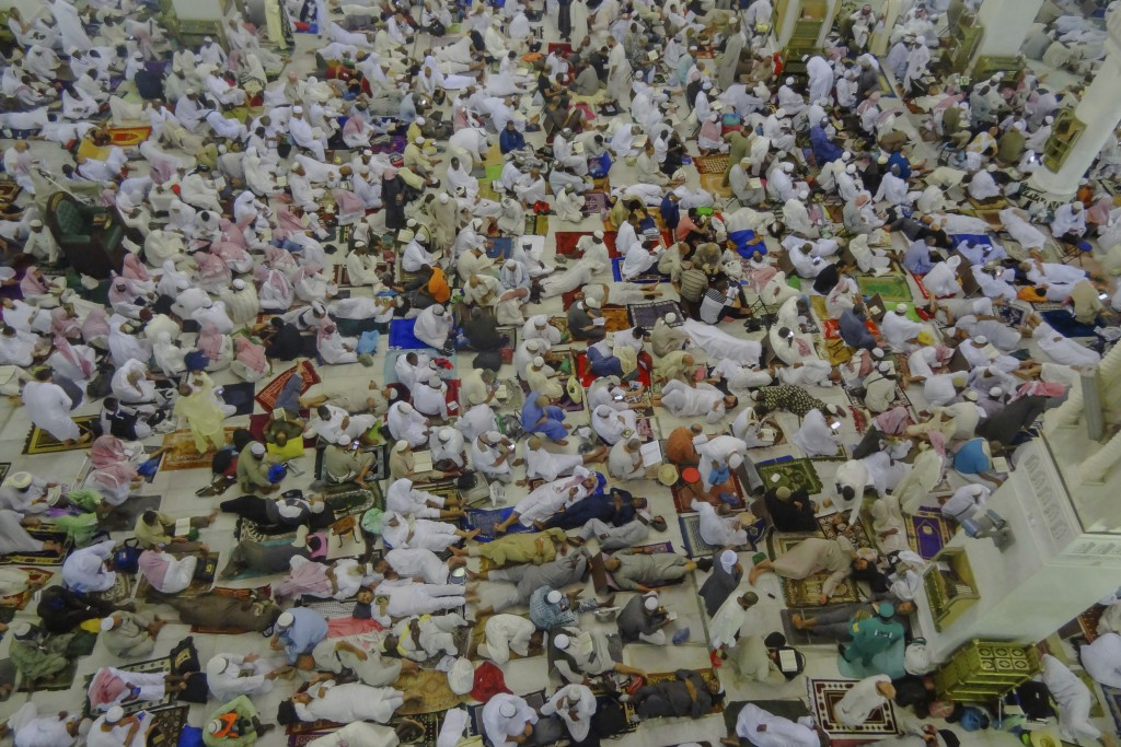 Muslim pilgrims rest inside the Grand Mosque, after offering Friday prayers ahead of the annual Hajj pilgrimage, in the Muslim holy city of Mecca, Sau...