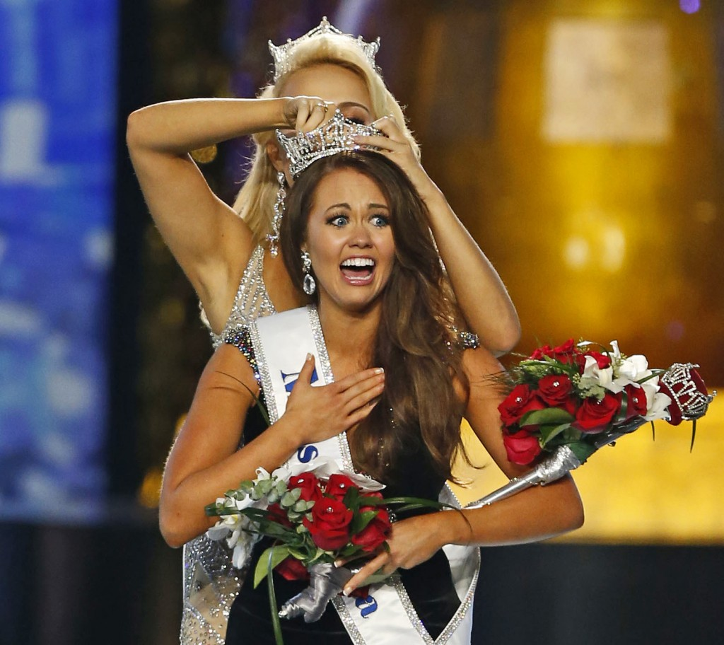 FILE – In this Sept. 10, 2017, file photo, Miss North Dakota Cara Mund reacts after being named Miss America during the Miss America 2018 pageant in A...