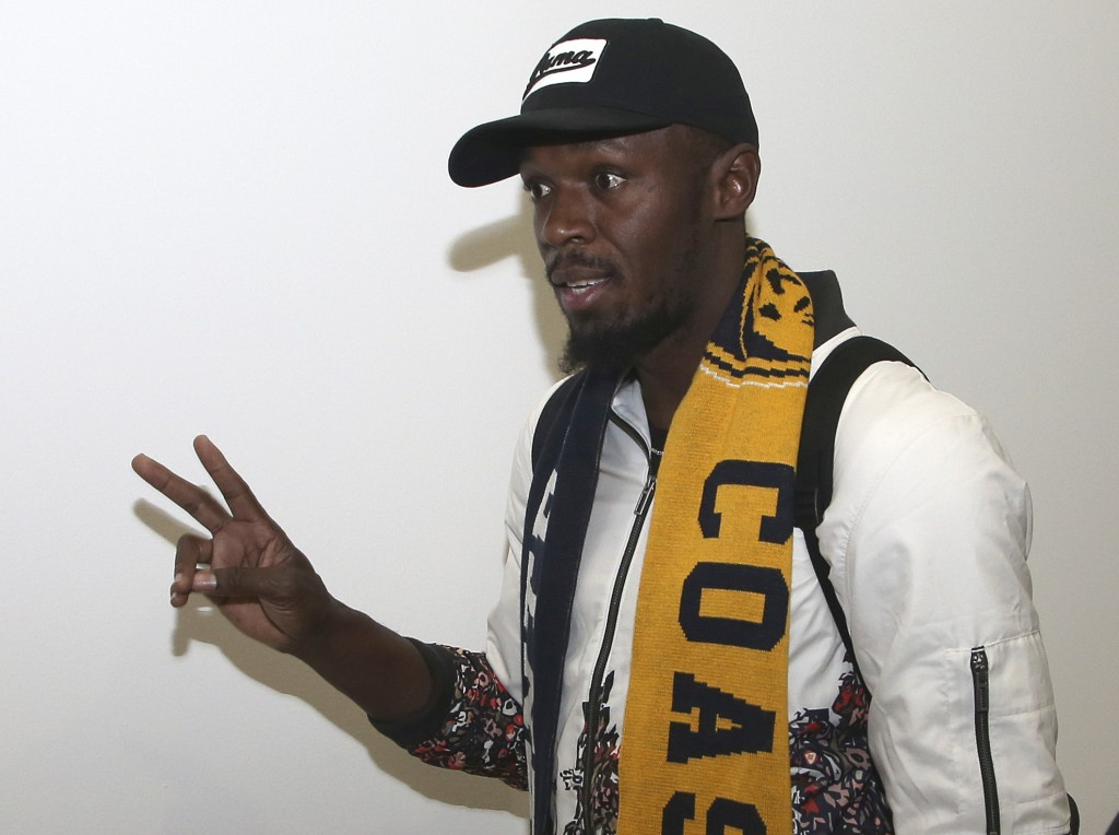 Jamaica's Usain Bolt waves as he arrives in Sydney, Saturday, Aug. 18, 2018. Olympic gold medalist sprinter, Bolt is hoping to impress the coaching st...