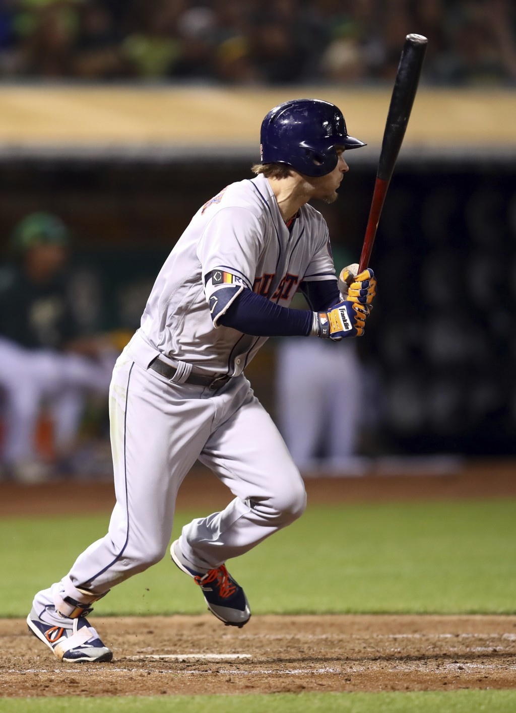 Houston Astros' Josh Reddick watches his RBI single against the Oakland Athletics during the sixth inning of a baseball game Friday, Aug. 17, 2018, in...
