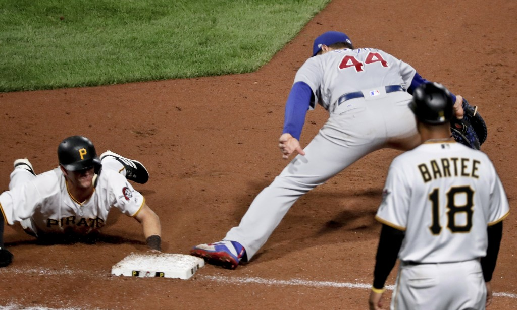 Pittsburgh Pirates' Kevin Newman, left, is doubled off first as Chicago Cubs first baseman Anthony Rizzo gets the throw from second baseman Javier Bae...
