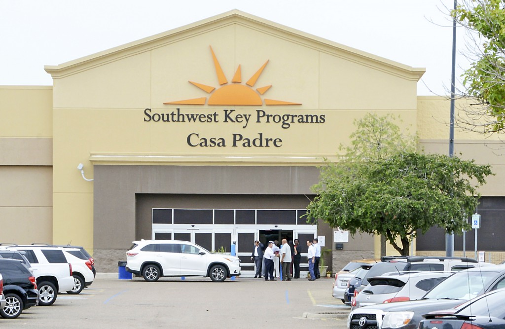 FILE - In this June 18, 2018, file photo, dignitaries take a tour of Southwest Key Programs Casa Padre, a U.S. immigration facility in Brownsville, Te...