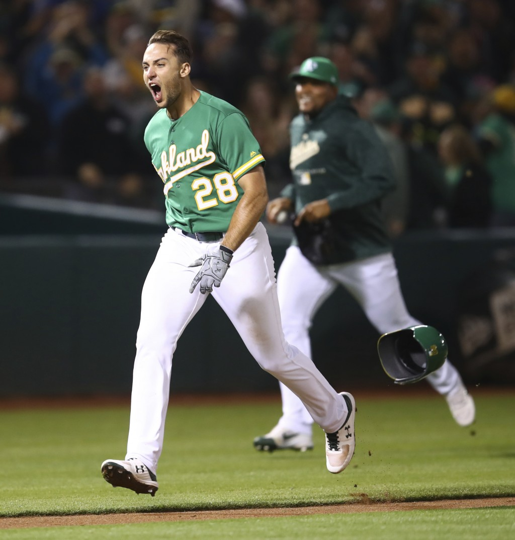 Oakland Athletics' Matt Olson celebrates after hitting the game winning home run off Houston Astros' Tony Sipp in the tenth inning of a baseball game ...