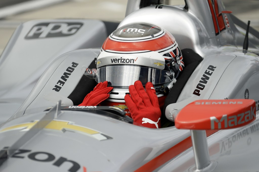 Will Power adjusts his visor before a practice session for Sunday's IndyCar series auto race, Saturday, Aug. 18, 2018, in Long Pond, Pa. (AP Photo/Mat...