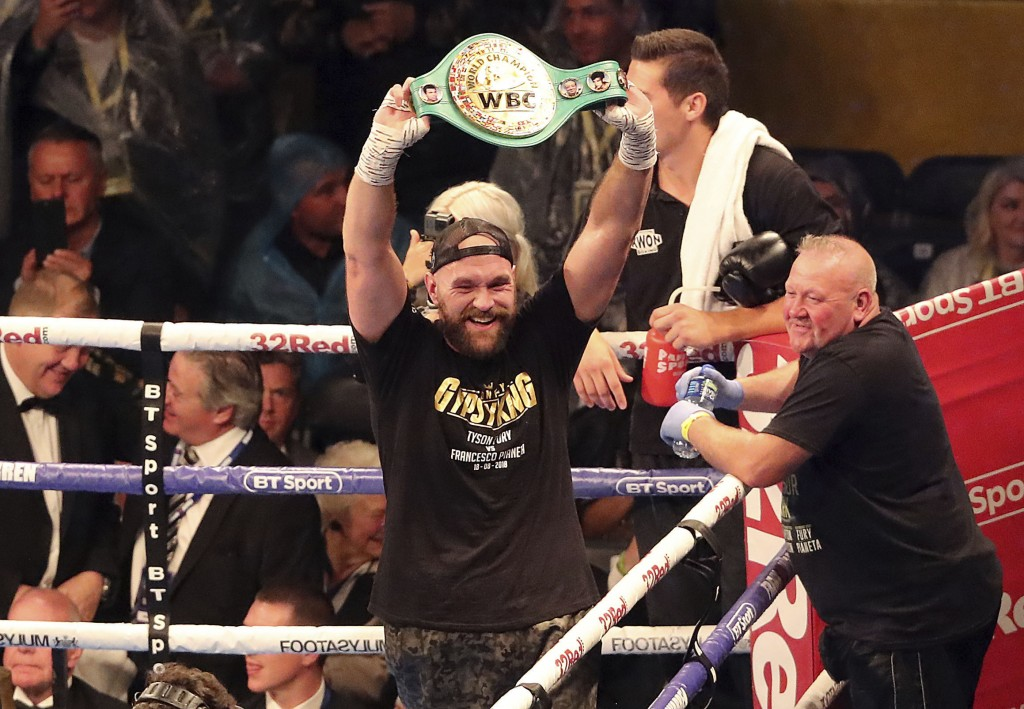 Tyson Fury holds the belt aloft as he celebrates victory against Francesco Pianeta during the Heavyweight fight at Windsor Park in Belfast, Northern I...