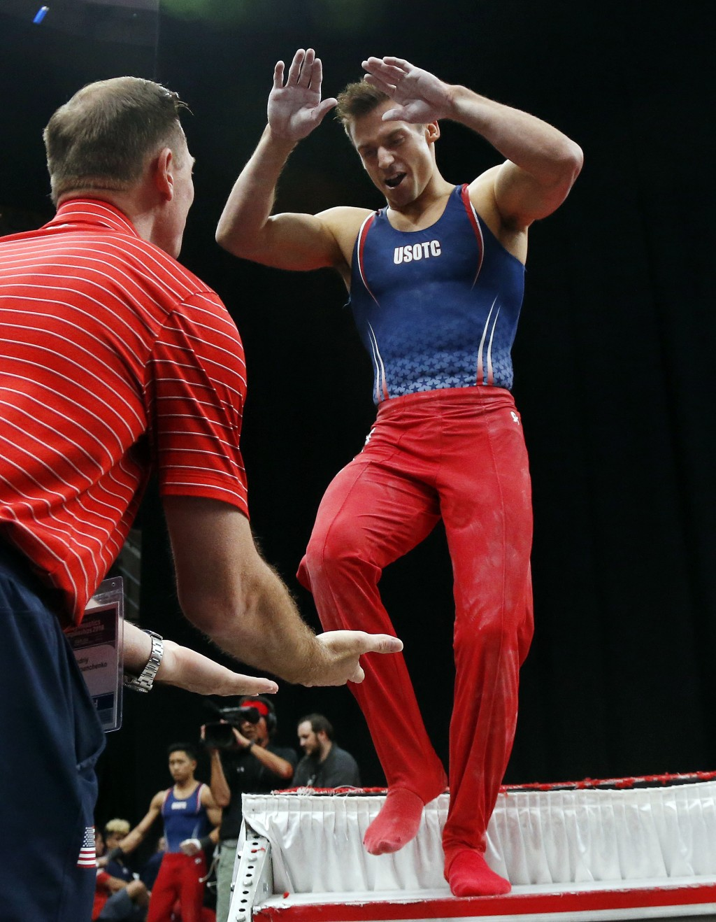 Sam Mikulak, right, celebrates after competing on the pommel horse at the U.S. Gymnastics Championships, Saturday, Aug. 18, 2018, in Boston. (AP Photo...