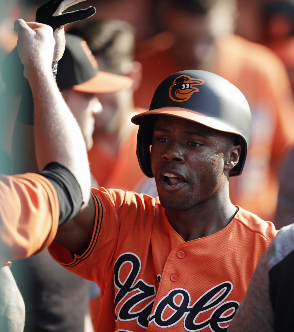 Baltimore Orioles' Cedric Mullins is congratulated by teammates after hitting a solo home run off Cleveland Indians relief pitcher Neil Ramirez in the...