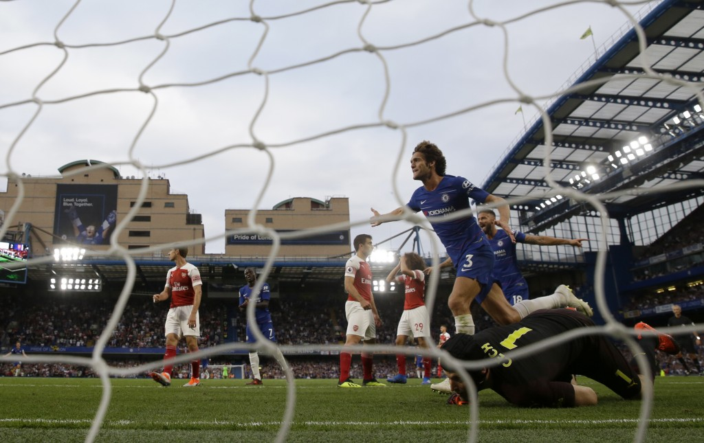 Chelsea's Marcos Alonso, top right, celebrates after scoring his side's third goal during the English Premier League soccer match between Chelsea and ...