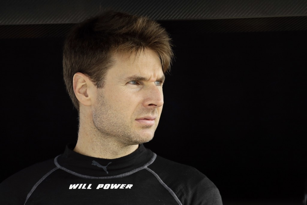 Will Power looks out from his pit box before a practice session for Sunday's IndyCar series auto race, Saturday, Aug. 18, 2018, in Long Pond, Pa. (AP ...