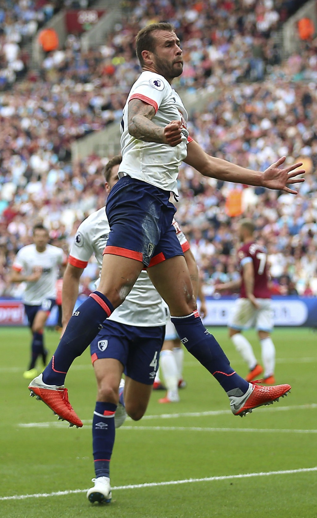 Bournemouth's Steve Cook celebrates scoring his side's second goal of the game against West Ham during their English Premier League soccer match at Lo...
