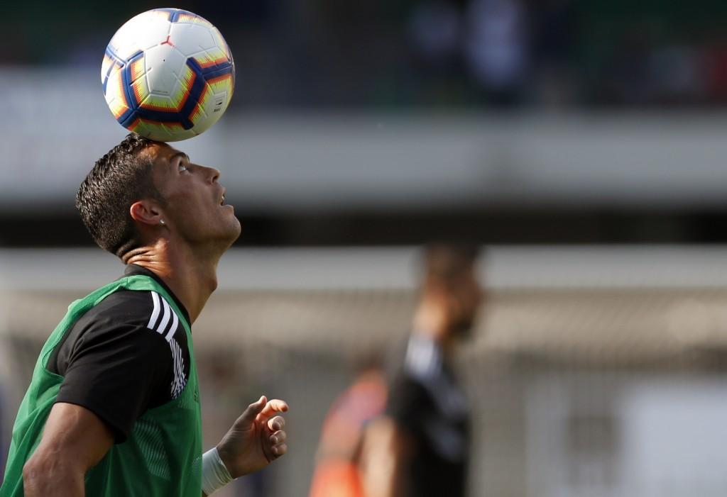 Juventus' Cristiano Ronaldo balances the ball on his head prior to the Serie A soccer match between Chievo Verona and Juventus, at the Bentegodi Stadi...