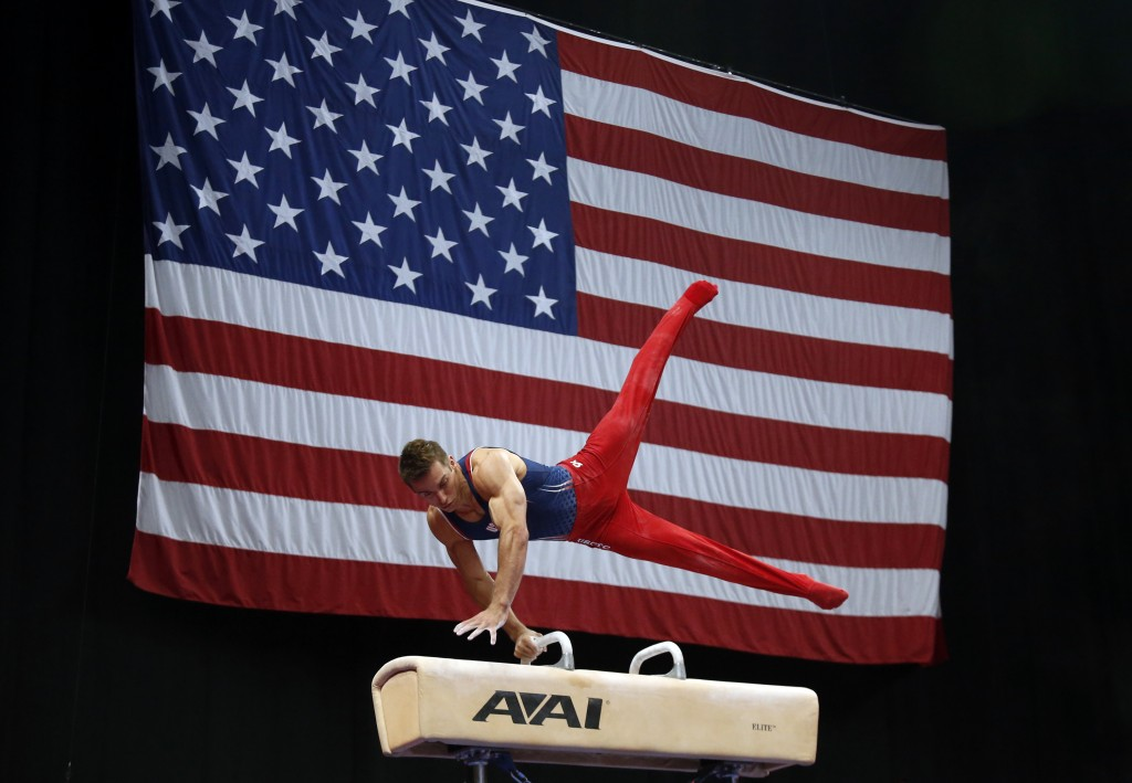 Sam Mikulak competes on the pommel horse at the U.S. Gymnastics Championships, Saturday, Aug. 18, 2018, in Boston. (AP Photo/Elise Amendola)