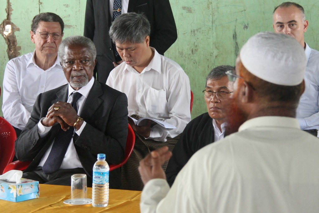 FILE - In this Sept. 27, 2016 file photo, former United Nations Secretary-General Kofi Annan, second left, listens to a Rohingya religious and communi...