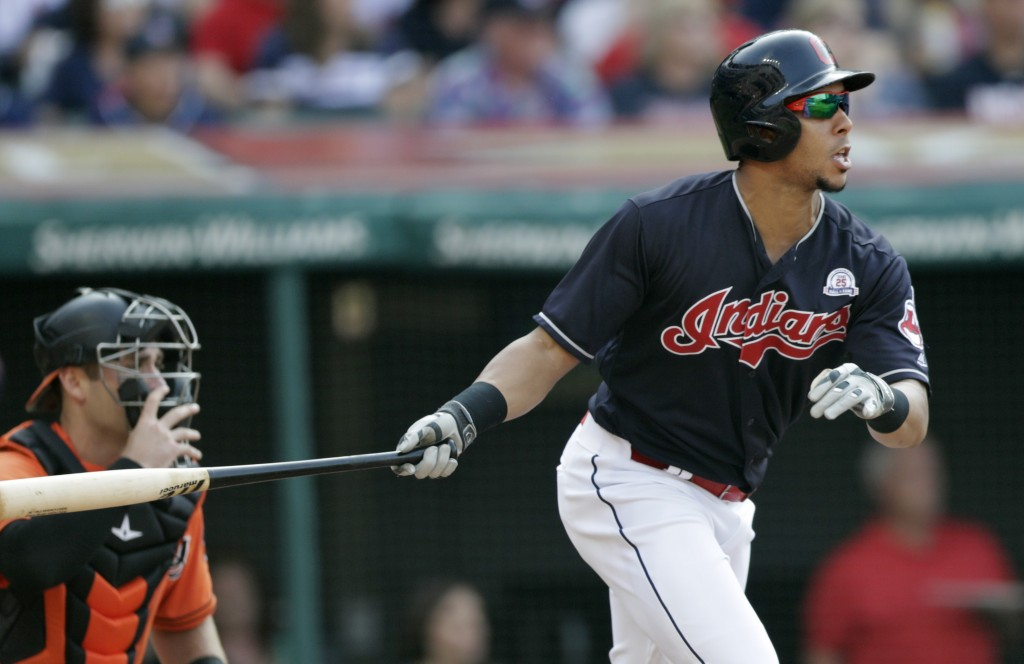 Cleveland Indians' Michael Brantley watches his ball after hitting a sacrifice fly off Baltimore Orioles starting pitcher Alex Cobb in the sixth innin...