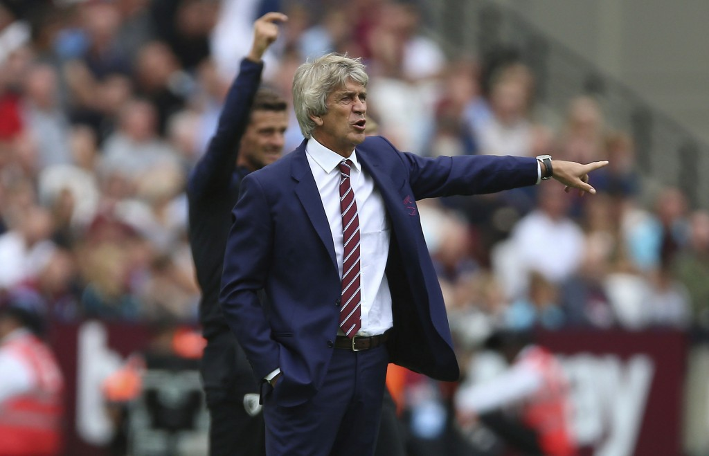 West Ham United manager Manuel Pellegrini instructs his players against Bournemouth during their English Premier League soccer match at London Stadium...