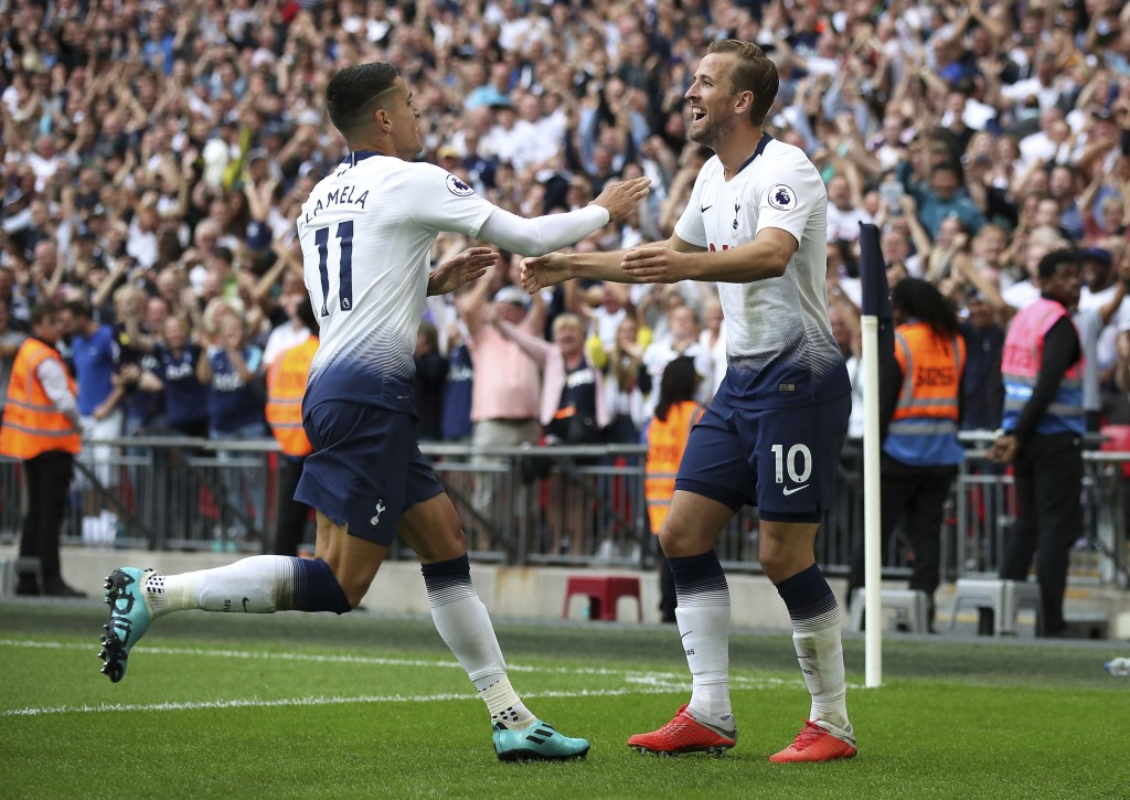 Tottenham Hotspur's Harry Kane, right, celebrates scoring his side's third goal of the game against Fulham, with team-mate Erik Lamela, during their E...