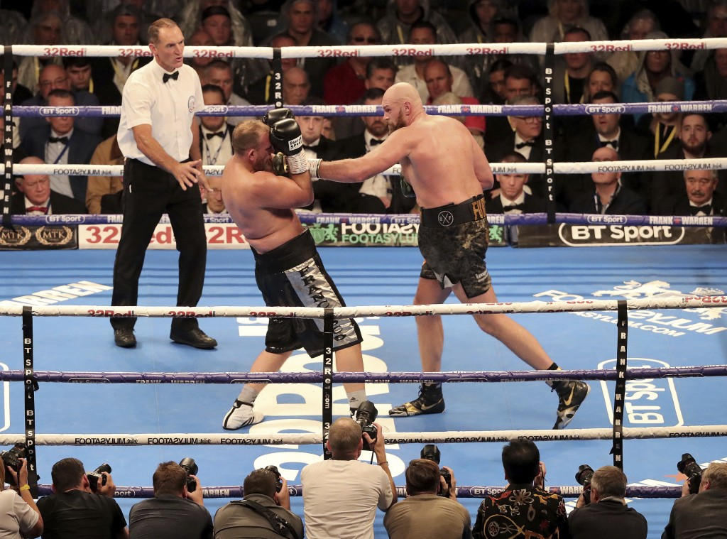 Tyson Fury, right, in action against Francesco Pianeta during their Heavyweight fight at Windsor Park in Belfast, Northern Ireland, Saturday Aug. 18, ...