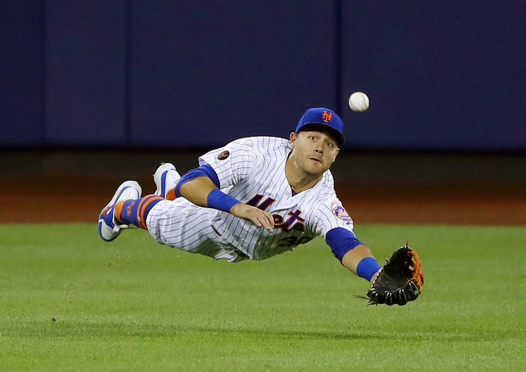 FILE - In this  June 23, 2018 file photo New York Mets center fielder Michael Conforto dives for but can't make the play on a ball hit by Los Angeles ...