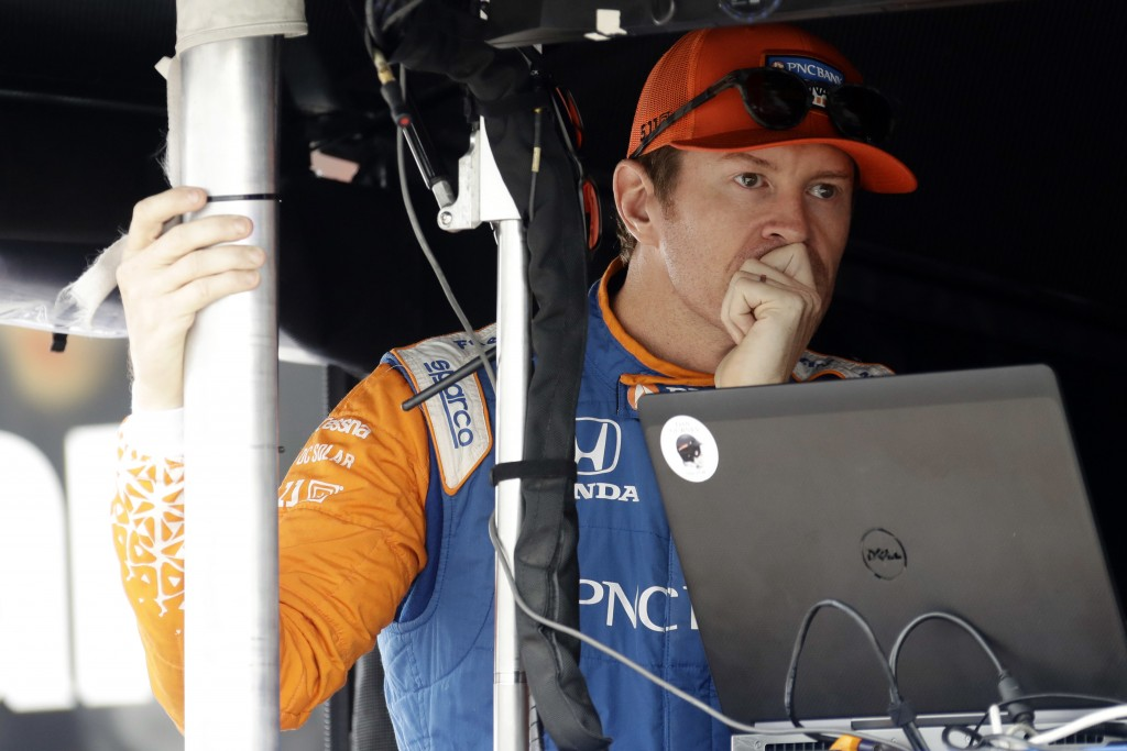 Scott Dixon waits in his pit box before a practice session for Sunday's IndyCar series auto race, Saturday, Aug. 18, 2018, in Long Pond, Pa. (AP Photo...