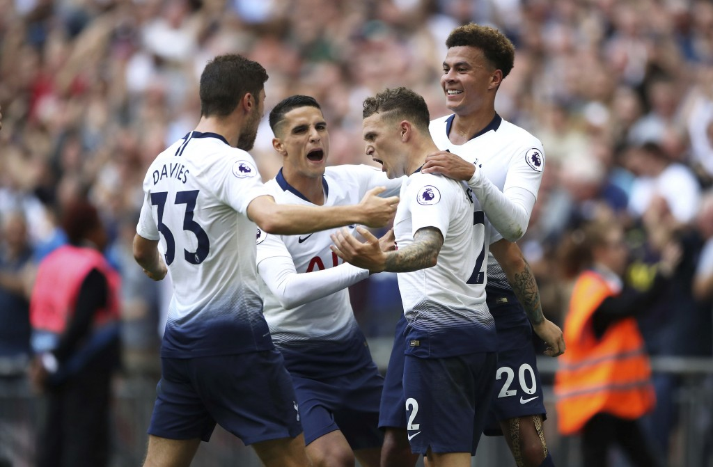 Tottenham Hotspur's Kieran Trippier, centre right, celebrates scoring his side's second goal of the game against Fulham during their English Premier L...