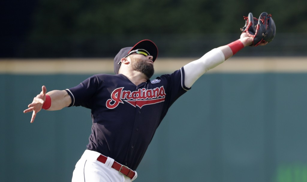 Cleveland Indians' Jason Kipnis catches a ball hit by Baltimore Orioles' Austin Wynns in the seventh inning of a baseball game, Saturday, Aug. 18, 201...