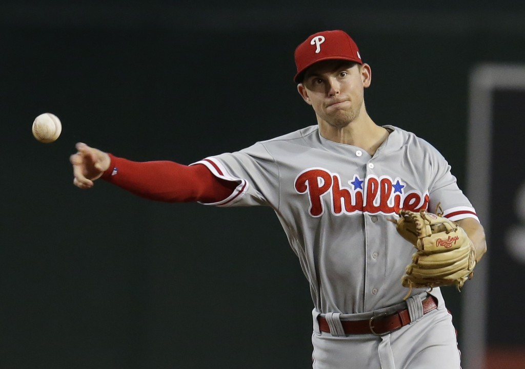 FILE - In this Aug. 8, 2018 file photo Philadelphia Phillies second baseman Scott Kingery (4) throws the ball in the first inning of a baseball game a...