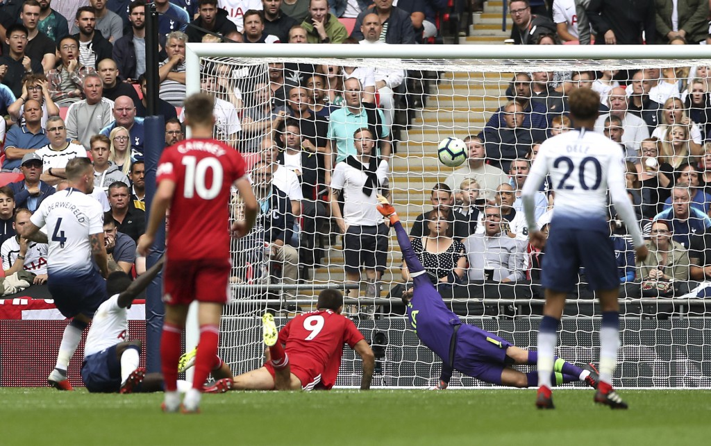 Fulham's Aleksandar Mitrovic, centre, scores his side's first goal of the game during their English Premier League soccer match at Wembley Stadium in ...