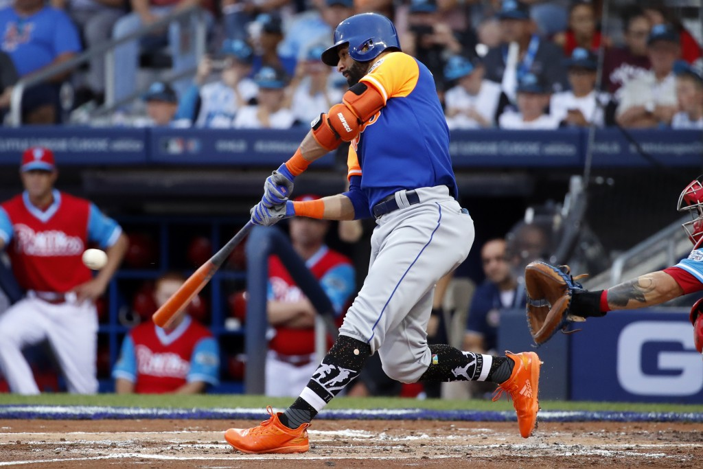 New York Mets' Jose Bautista drives in a run with a single off Philadelphia Phillies starting pitcher Adam Morgan in the second inning of the Little L...