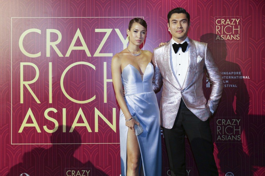 """Actor Henry Golding and his wife Liv Lo pose as they arrive for the red carpet screening of the movie """"Crazy Rich Asians"""" on Tuesday, Aug. 21, 2018, i..."""