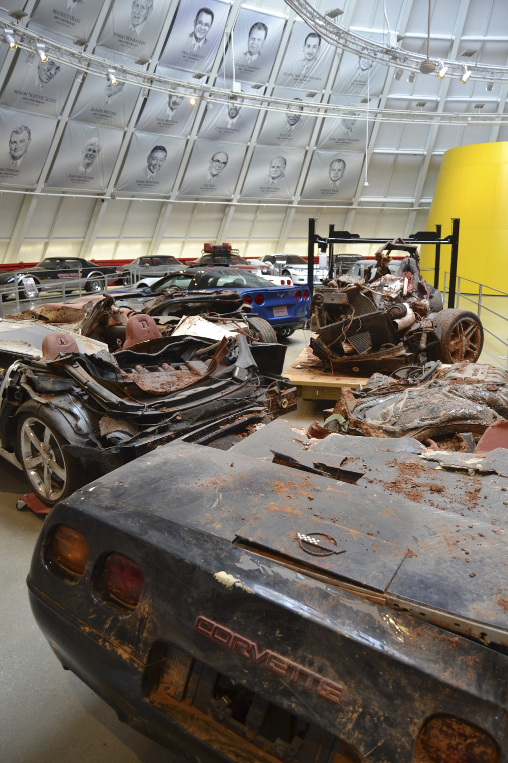 In this Nov. 19, 2017 photo vehicles damaged during a sinkhole cave-in are displayed at the National Corvette Museum in Bowling Green, Ky. (Christophe...