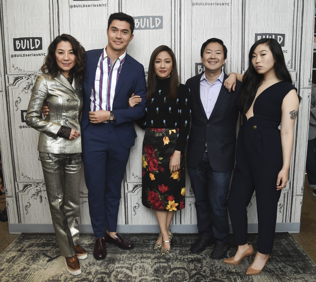 FILE: In this Aug. 14, 2018, file photo, Actors Michelle Yeoh, from left, Henry Golding, Constance Wu, Ken Jeong and Awkwafina participate in the BUIL...
