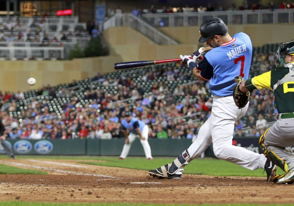 Minnesota Twins' Joe Mauer hits a single against the Oakland Athletics in the fifth inning during a baseball game Friday, Aug. 24, 2018, in Minneapoli...