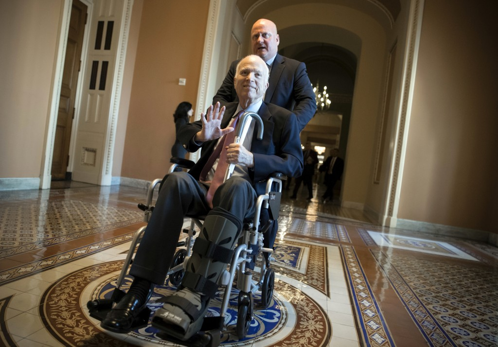 FILE - In this Dec. 1, 2017, file photo, Sen. John McCain, R-Ariz., leaves a closed-door session on Capitol Hill in Washington, where Republican senat