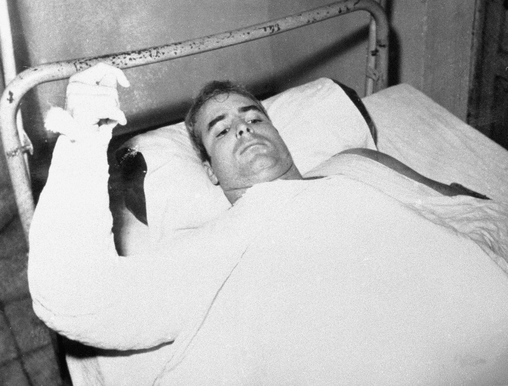 FILE - In this undated file photo provided by CBS, U.S. Navy Lt. Commander John S. McCain lies injured in North Vietnam. McCain, the war hero who beca