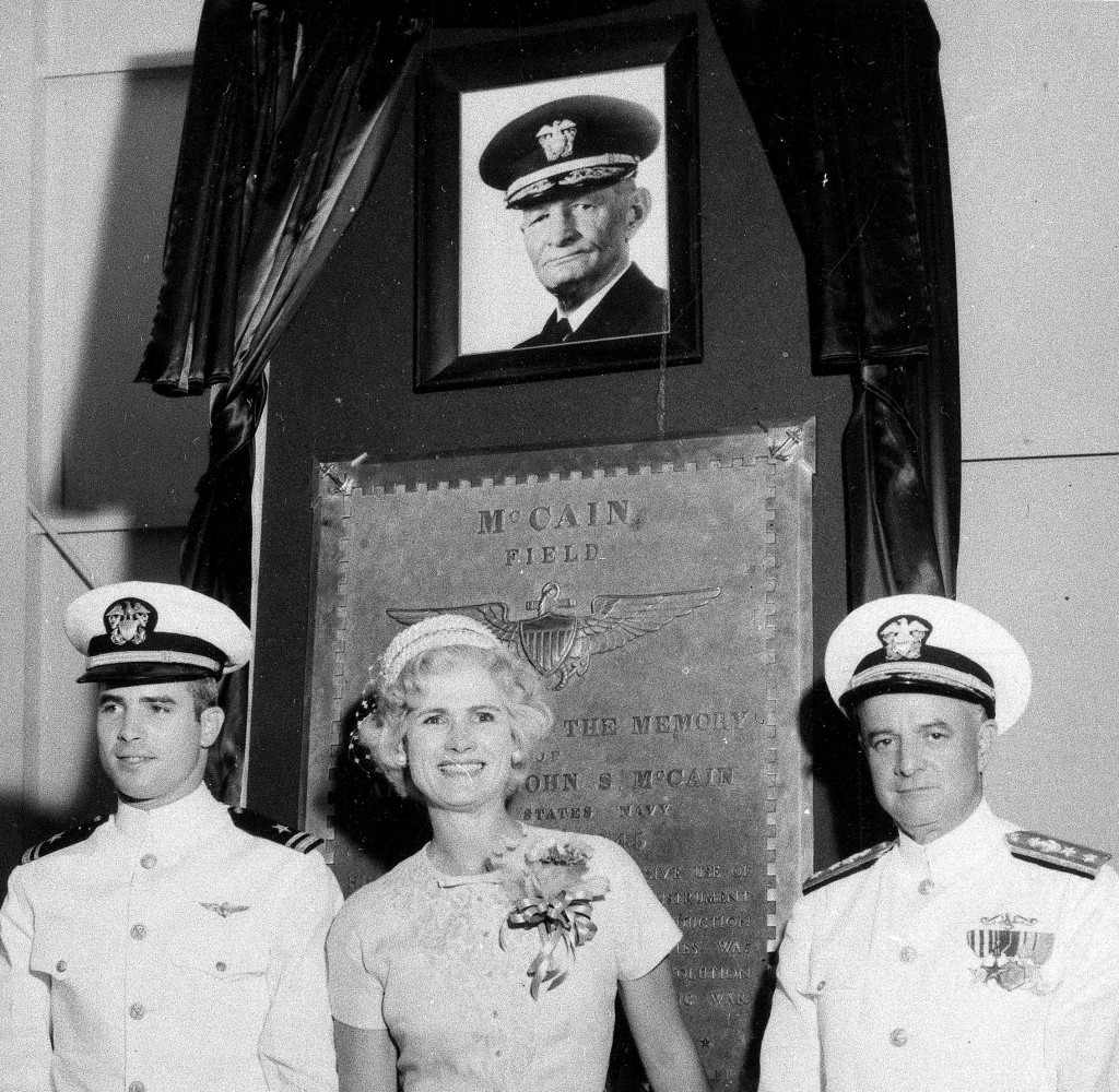 FILE - In this July 14, 1961, file photo, U.S. Navy Lt. John S. McCain III, left, and his parents, Rear Adm. John S. McCain Jr., right, and Roberta Wr